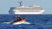 The U.S. Coast Guard patrols near the cruise ship Carnival Triumph in the Gulf of Mexico. The ship was left adrift after an engine room fire. Now problems have been reported aboard the Carnival Dream. (US COAST GUARD/REUTERS)