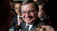Finance Minsiter Jim Flaherty speaks to reporters in the foyer of the House of Commons on Sept. 28, 2011. (Adrian Wyld/THE CANADIAN PRESS)