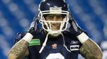 Toronto Argonauts Chad Owens puts on his helmet during team practice ahead of the 100th Grey Cup championship CFL game in Toronto, November 22, 2012. (MARK BLINCH/REUTERS)
