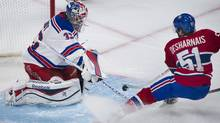 Montreal Canadiens' David Desharnais slides in on New York Rangers goaltender Cam Talbot during first period NHL hockey action in Montreal, Saturday, November 16, 2013. (GRAHAM HUGHES/THE CANADIAN PRESS)