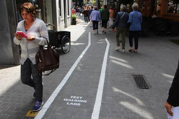 Text walking lanes introduced for phone users in Antwerp, Belgium. It is an initiative of Mlab, smartphone laboratory located in the city.