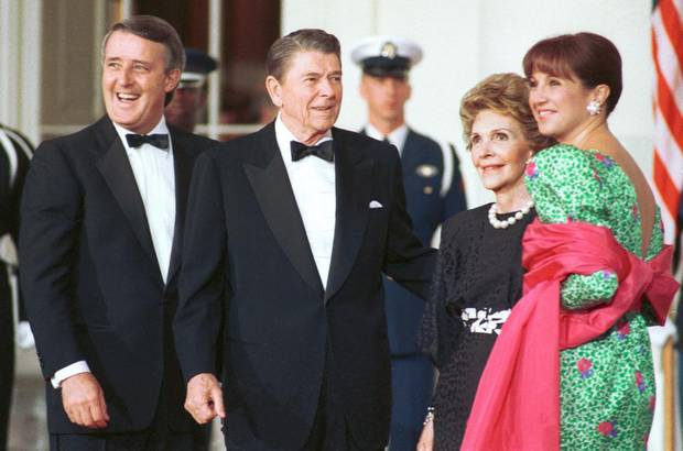 Ronald Reagan and his wife Nancy stand with Brian Mulroney and his wife Mila before a state dinner at the White House in 1988.