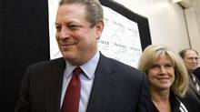 Former U.S. Vice President Al Gore and his wife Tipper leave a 2007 press conference after Mr. Gore won the Nobel Peace Prize (KIMBERLY WHITE)