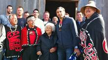 Vancouver Canucksgoalie Roberto Luongo, second from right, poses with Haida matriarch Mary Swanson, a lifelong Canucksfan who turned 89 on Sept. 7 and was among those in the First Nations village of Old Massett who welcomed the team during a visit on Tuesday. (David Ebner/The Globe and Mail)