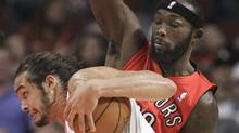 Chicago Bulls center Joakim Noah, foreground, drives on Toronto Raptors forward Reggie Evans during the first quarter of an NBA basketball preseason game Tuesday, Oct. 12, 2010, in Chicago. (AP Photo/Charles Rex Arbogast) (Charles Rex Arbogast)