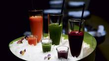 Try one of David Lee's summer juices: Sea buckthorn berry and carrot juice; ginger root, apple and celery juice; and beetroot juice (Michelle Siu for The Globe and Mail)