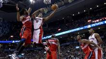 Toronto Raptors guard DeMar DeRozan (10) drives to the hoop against Washinton Wizards centre Nene (42) during first half NBA action in Toronto on Monday February 25, 2013. (Frank Gunn/THE CANADIAN PRESS)