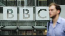 A pedestrian walks past a BBC logo at Broadcasting House in central London October 22, 2012.= (OLIVIA HARRIS/Reuters)
