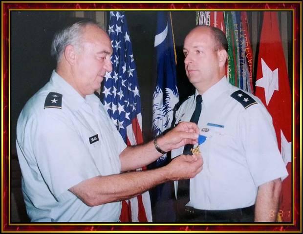 Robert E. Lee Goodwin III, right, is awarded the Palmetto Cross.