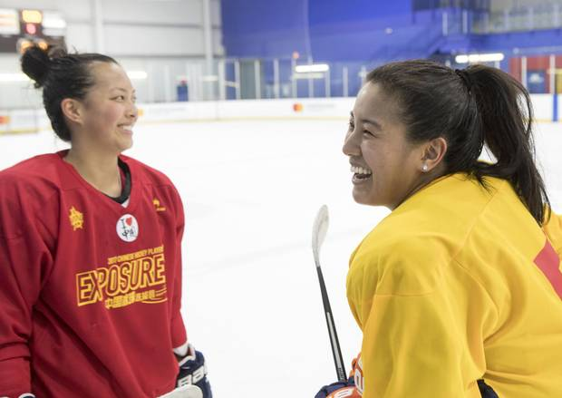 Leah Lum, left, and Emily Costales share a joke a session at an identification camp for the CWHL's Kunlan Red Star on Tuesday.