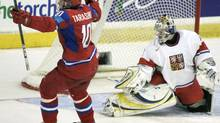 Team Russia's Vladimir Tarasenko scores a goal on Team Czech Republic goalie Alexander Pechursky during third period preliminary world junior hockey championship action in Regina, Sask., Thursday, Dec. 31, 2009. Russia won by 5-2. THE CANADIAN PRESS/Geoff Howe (GEOFF HOWE)