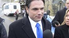 Senator Patrick Brazeau talks to media on Parliament Hill in Ottawa, Tuesday, Feb.12, 2013. (Adrian Wyld/THE CANADIAN PRESS)