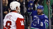 Vancouver Canucks Chris Higgins (R) celebrates his goal against the Detroit Red Wings during the first period of their NHL game in Vancouver, British Columbia December 21, 2011. (BEN NELMS/REUTERS)