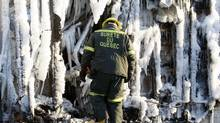 Investigators sift the ruins of a Quebec seniors home, where 10 people are confirmed dead and 22 are believed to missing after Thursday's blaze. (Reuters)