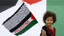 Zena, a 6-year-old Belgian-Palestinian girl, waves a Palestinian flag during a protest in central Brussels. Palestinian President Mahmoud Abbas plans to submit an application for full U.N. membership for the state of Palestine. (FRANCOIS LENOIR/REUTERS)