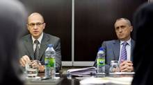 Sergey Kirienko, left, director general of Russia's Rosatom, and Vadim Zhivov, director general of ARMZ Uranium Holding Co., talk with reporters in Toronto on Tuesday (Sarah Dea/The Globe and Mai/Sarah Dea/The Globe and Mai)