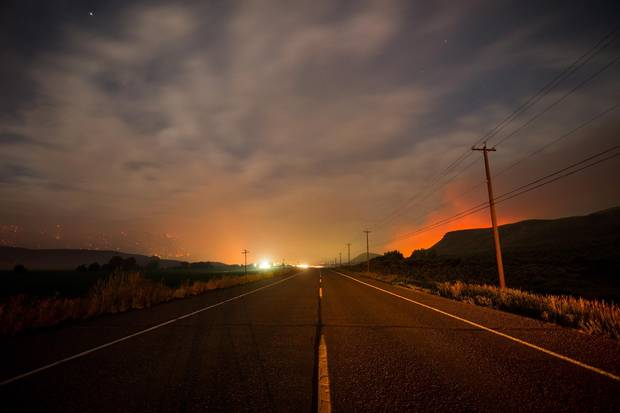 Smoke hangs in the air above the Trans-Canada Highway as wildfires burn on mountains near Ashcroft, B.C., last Friday.