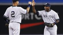 New York Yankees Alfonso Soriano and Derek Jeter celebrate defeating the Toronto Blue Jays after their American League baseball game in Toronto, August 27, 2013. (MARK BLINCH/REUTERS)