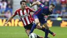 Manchester United's Tom Cleverley, right, challenges Sunderland's Jordi Gomez on Sunday. A week after losing the season opener to Swansea, United was held to a 1-1 draw at Sunderland. (ANDREW YATES/REUTERS)
