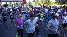 Runners begin the Goodlife Fitness Toronto Marathon on Sunday, May 5, 2013. (Matthew Sherwood For The Globe and Mail)