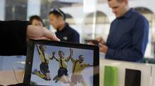 The new iPad Air is displayed on Nov. 1, 2013, in Stanford, Calif. ComScore Inc. announced that it will be bringing its mobile measurement system, already in use in the U.S. and the United Kingdom, to Canada. (Marcio Jose Sanchez/AP)