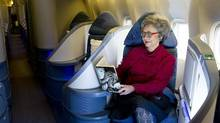 Adrienne Clarkson reads Keith Richards' memoirs in the business class section of a passenger jet at Pearson Airport in Toronto. (Kevin Van Paassen/The Globe and Mail)