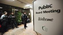 Police officers stand guard outside a Toronto District School Board meeting in Toronto on March 5, 2013. (Michelle Siu for The Globe and Mail)