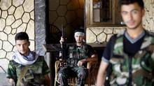 Free Syrian Army fighters take a break from clashes in a coffee shop in Aleppo in this August 12, 2012 file photo. (GORAN TOMASEVIC/REUTERS)