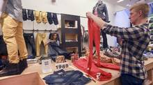 Employees tidy up at a Gap store in the SoHo neighborhood of New York in this file photo. (Hiroko Masuike/The New York Times)