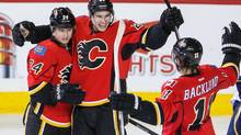 Calgary Flames left wing Jiri Hudler (24) celebrates his goal with centre Sean Monahan (23) and center Mikael Backlund (11) against the St. Louis Blues during the second period at Scotiabank Saddledome. (Sergei Belski/USA Today Sports)