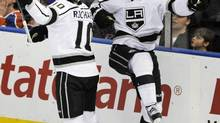 Los Angeles Kings' Jeff Carter (R) celebrates his winning goal with teammate Mike Richards during the third period of their NHL game against the Edmonton Oilers in Edmonton February 19, 2013. (DAN RIEDLHUBER/REUTERS)