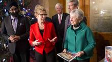 Ontario Premier Kathleen Wynne stands with Anne Golden, chair of the transit investment strategy advisory panel, as she receives the transit investment report at Queens Park. (Fred Lum/The Globe and Mail)