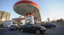 Motorists at a gas station at Overlea Blvd and Leaside Park Crescent fill their tanks. (Fred Lum/Fred Lum/The Globe and Mail)