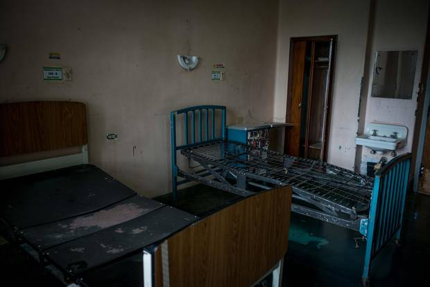 A two-bed room at Clinic University Hospital, unusable due the lack of cleaning supplies, bathrooms and mattresses.