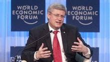Prime Minister Stephen Harper delivers his address to business leaders at the World Economic Forum in Davos, on Jan. 26, 2012. (Adrian Wyld/The Canadian Press/Adrian Wyld/The Canadian Press)
