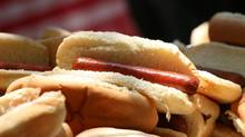 Hot dogs are made of processed meat and they're loaded with cholesterol-raising saturated fat and sodium. (Mark Lennihan/AP)