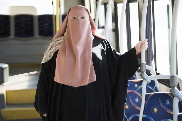 Warda Naili wears a niqab a city bus in Montreal on Oct. 21, 2017. Ms. Naili says the first time she donned a niqab six years ago, it became a part of her. The Quebec woman, a convert to Islam, said she decided to cover her face out of a desire to practice her faith more authentically and to protect her modesty.