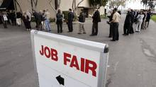 File photo of job seekers waiting in line at a jobs fair in San Mateo, Calif. (Paul Sakuma/AP Photo)