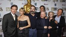 Cast members (from left) Cary Elwes, Robin Wright, Mandy Patinkin, Wallace Shawn, Chris Sarandon, Carol Kane, and Billy Crystal of the Princess Bride pose for a photograph as they arrive for a special 25th anniversary viewing of the film during the New York Film Festival in New York, October 2, 2012. (LUCAS JACKSON/REUTERS)