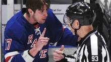 New York Rangers' Brandon Dubinsky (L) is ejected from the game for fighting against the Ottawa Senators during the first period of Game 2 of their NHL Eastern Conference quarter-final playoff hockey game at Madison Square Garden in New York April 14, 2012. REUTERS/Ray Stubblebine (Ray Stubblebine/Reuters)