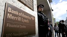 A police officer guards the entrance to a Bank of America Merrill Lynch office in London, U.K., on Tuesday, May 15, 2012. Royal Bank of Canada is said to be interested in acquiring B of A's wealth management business outside the U.S. (Simon Dawson/Bloomberg News/Simon Dawson/Bloomberg News)