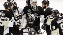 Pittsburgh Penguins players celebrate around goalie Marc-Andre Fleury after the Pengiuns defeated the Detroit Red Wings 2-1 in Game 6 of the NHL Stanley Cup final in Pittsburgh, Pennsylvania, June 9, 2009. The series is now tied 3-3. (JASON COHN)