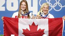 Heather Moyse and Kaillie Humphries during a press conference in Sochi. The women have been chosen to carry the Canadian flag for the closing ceremony on Sunday. (John Lehmann/The Globe and Mail)