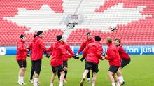 Members of Canada's national men's soccer team practice on Wednesday, Oct. 10, 2012. (Nathan Denette/The Canadian Press)