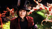 Actor Johnny Depp portrays the character Willy Wonka in a scene from Charlie and The Chocolate Factory in this undated publicity photograph. (HO/REUTERS)