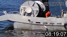 A video framegrab showing commercial fishermen kicking salmon off a boat's deck or throwing apparently lifeless fish overboard has triggered a federal investigation into possible violations of the Fisheries Act. (YouTube)