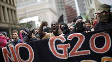 Demonstrators march in protest at the G20 Summit in Pittsburgh on Sept. 25, 2009. (CARLOS BARRIA/Carlos Barria/Reuters)