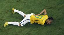 Brazil's Neymar was injured on Friday in a quarter-final against Colombia. He has a fractured vertebra and won't be back at the World Cup. (FABRIZIO BENSCH/REUTERS)