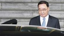 South Korean Prime Minister Chung Hong-won leaves after announcing his resignation at a news conference at the Integrated Government Building in Seoul April 27. (YONHAP/REUTERS)