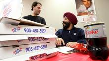 Navdeep Bains, federal Liberal candidate for the riding of Mississauga - Brampton South, talking to volunteer Dan Deyan (left) in Brampton. (Tim Fraser/Tim Fraser for The Globe and Mail)